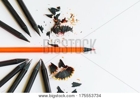 Creative Layout Of Black And One Red Pencil On White Background. Break Through And Be Different Conc