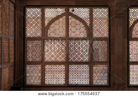 FATEHPUR SIKRI, INDIA - FEBRUARY 15: Intricate window artwork in the tomb of Salim Chishti at Fatehpur Sikri complex, Uttar Pradesh, India on February 15, 2016.