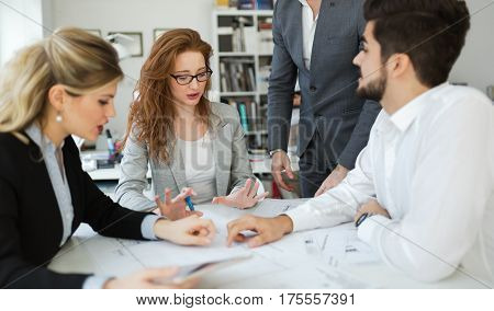 Business meeting and cooperation by business people in office