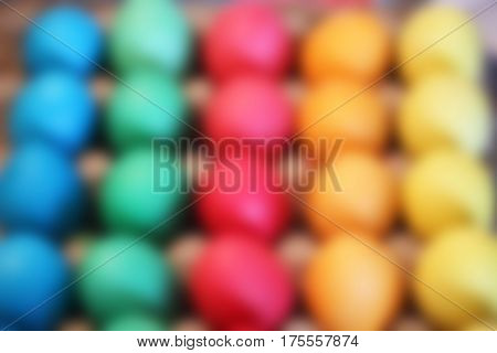 Many brightly colored Easter eggs. Blurred celebratory background holiday