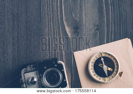 Old Compass And Camera On A Dark Wooden Background
