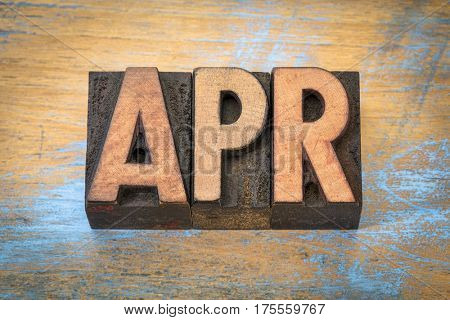 Apr - April month abbreviation in vintage letterpress wood type against grunge wooden background
