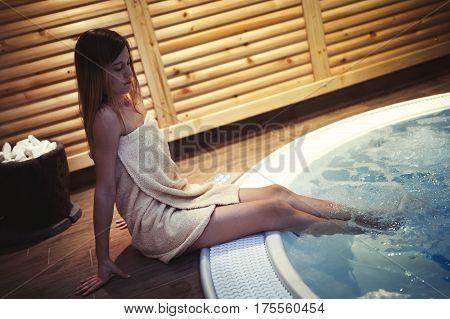 Woman Enjoying Jacuzzi In Spa