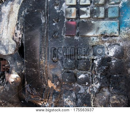 Charred and melted computer keyboard after the fire. Close up.