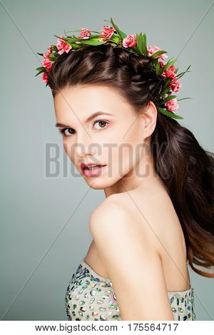 Beautiful Girl Fashion Model with Prom Hairstyle and Flowers Wreath. Young Woman