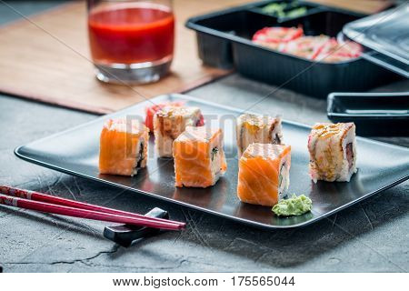 Sushi roll : Set of salmon eel sushi rolls on plate with chopsticks