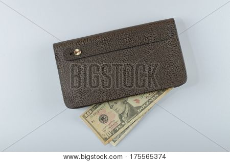 Brown man purse dollar isolated on white background