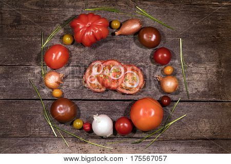 concept ingredients of a tomato sandwich on a wooden background