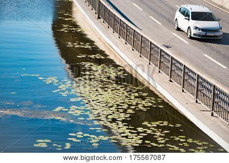 Modern white car in street near water in Stockholm Sweden Scandinavia Europe.