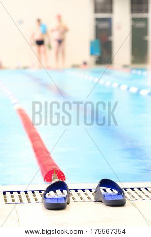 mule shoes in a swimming pool