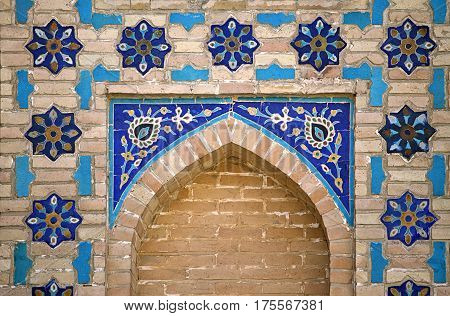 Ornate window niche in the wall, Bukhara, Uzbekistan