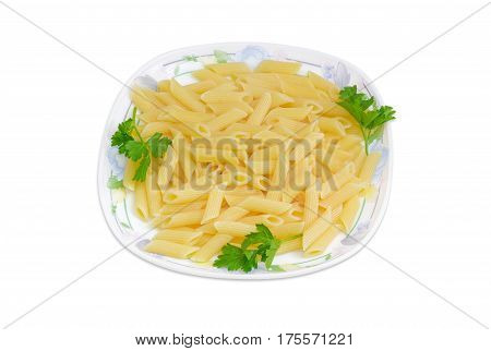Cooked cylinder-shaped pasta decorated with a small parsley twigs on a dish on a light background