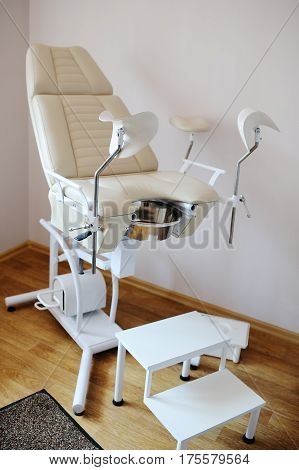 beautiful modern gynecological chair a light beige color in the clinic closeup