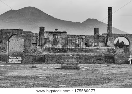 Pompeii, Temple of Jupiter with Vesuvius in the distance. Naples Italy