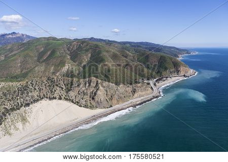 Aerial view of coastal sand dune and Pacific Coast Highway north of Malibu in Southern California.
