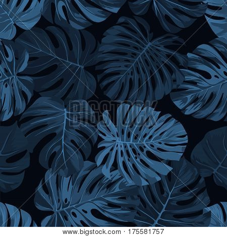 Dark blue indigo pattern with monstera palm leaves on dark background. Seamless summer tropical fabric design. Vector illustration.