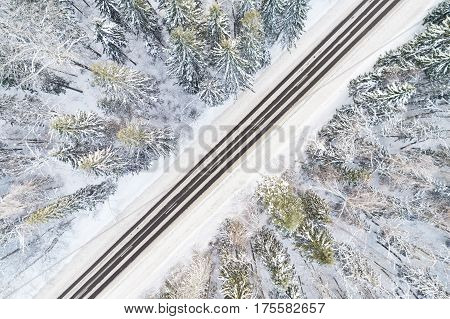 Aerial View Of Road In Winter Forest