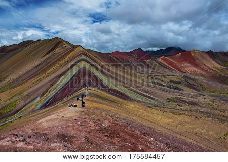 Rainbow Mountain outside of Cusco, also known as Ausangate.  Its color is due to mineral erosion.