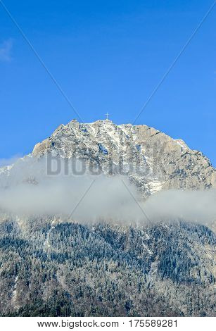 Carpathian Mountains, Bucegi With Cross In Top Of Caraiman Peak, Clouds, Snow And Fog, Winter Time L