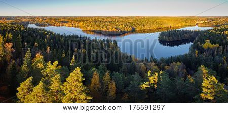 Peaceful panorama lake view with fall colors at Aulanko nature park in Finland.