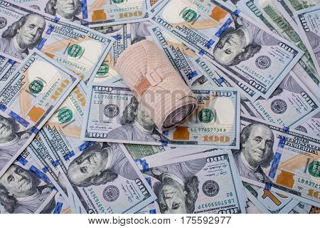 A bandaid on a Banknote bundle of US dollar