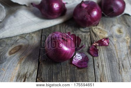 Red onions in the husk close up