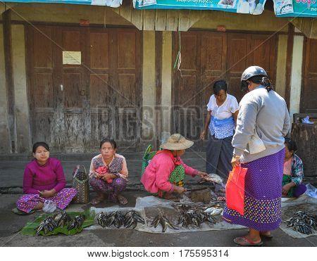 Vendor At The Local Market In Myanmar