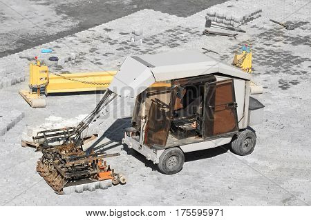 Paving stone machine on road construction site