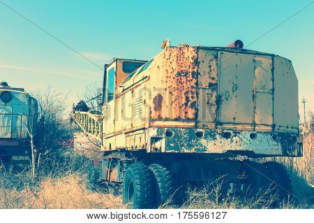 Old Rusty Construction Crane. The Crisis In Ukraine, The Fall Of The Economy, The Stop Of Production