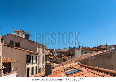 Antibes, France - June 26, 2016: day view of old town roofs and skyline in Antibes France. It is one of the most well known resorts on the Cote d'Azur located between Nice and Cannes.