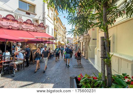 Antibes France - June 27 2016: day view of main street Rue de la Republique with tourists in Antibes France.