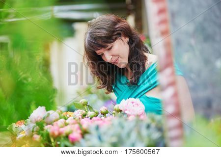 French Woman Choosing Flowers On Market