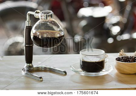 Close Up Of Siphon Vacuum Coffee Maker At Shop.