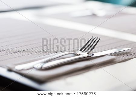 Fork, Knife And Napkin On Table