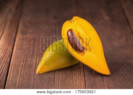 Egg fruit Canistel Yellow Sapote (Pouteria campechiana (Kunth) Baehni) on dark background
