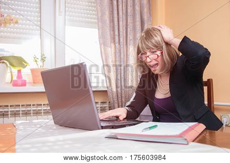 Stressed and terrified young corporate business woman gasping