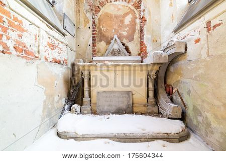 LVIV, UKRAINE - Feb 14, 2017: Inside view of Ancient crypt in the Lychakivskyj cemetery of Lviv, Ukraine. Officially State History and Culture Museum-Preserve - Lychakiv Cemetery