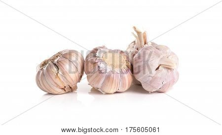 Fresh organic garlic cloves and cutted garlic clove isolated on white background