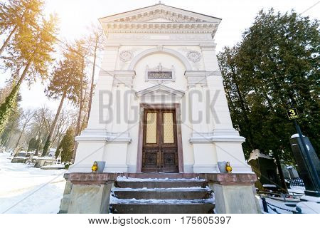 LVIV, UKRAINE - Feb 14, 2017: Ancient crypt Baczewskich in the Lychakivskyj cemetery of Lviv, Ukraine. Officially State History and Culture Museum-Preserve - Lychakiv Cemetery