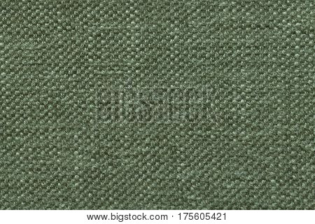 Green olive knitted woolen background with a pattern of soft fleecy cloth. Texture of textile closeup.