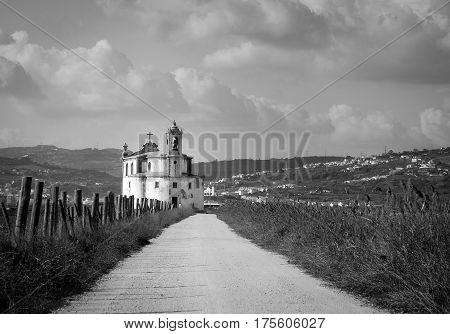 Christian church in plain with mountains in background (black and white)