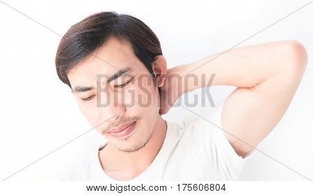 Closeup young man neck ache with white background