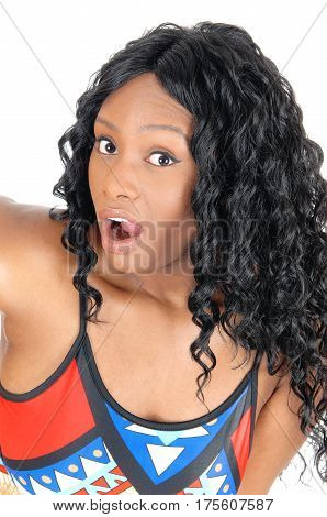 A closeup image of a very surprised African American woman with big eyes and open mouth isolated for white background.