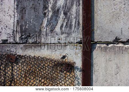 Concrete blocks rusty metal bar and rusty metal mesh.