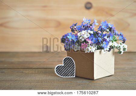 Father's Day card with colorful spring  flowers arranged in gift box