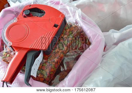 red label price tag on pet food in sack bag