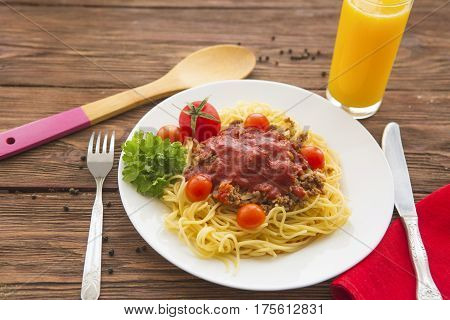 Low Angle View Of A Serving Of Italian Spaghetti With Bolognese