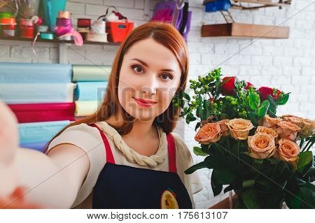 attractive young girl working in a flower shop