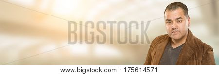 Handsome Adult Hispanic Male Portrait Wide Banner with Room For Text.