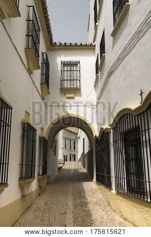 Ronda (Andalucia Spain): old typical street with white houses